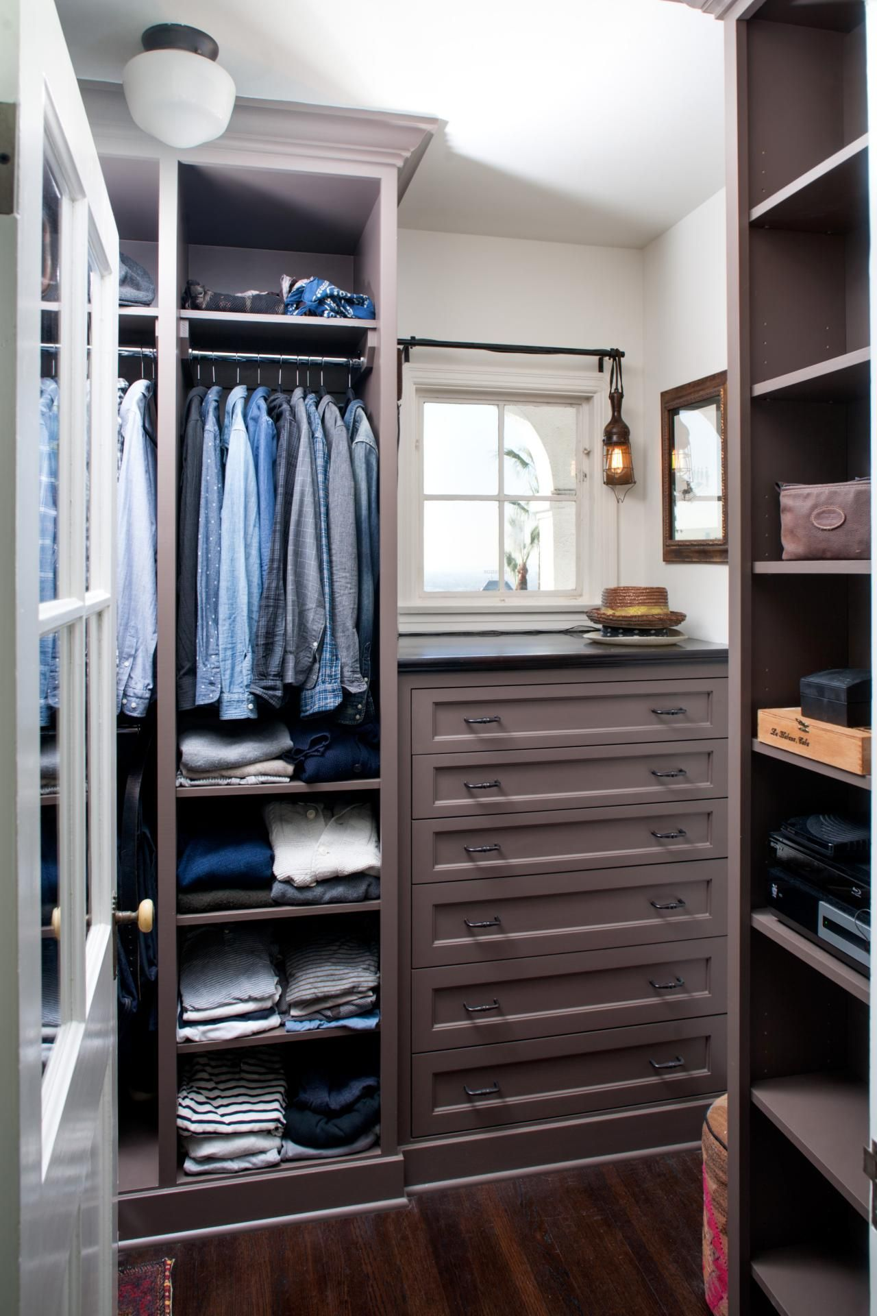 Built in storage fixtures provide maximum storage in this - Mens walk in closet ...