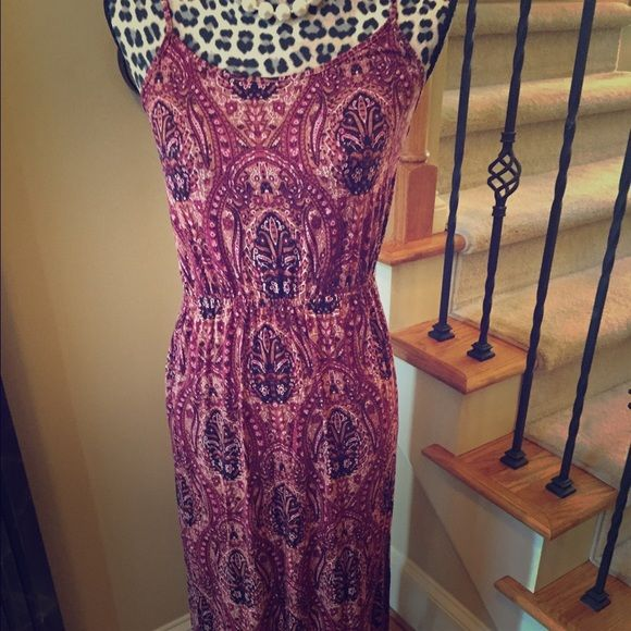 American eagle outfitters long knit dress Beautiful paisley print long knit dress with side slit.  Adjustable straps and very comfortable.  With tags never been worn. American Eagle Outfitters Dresses Maxi