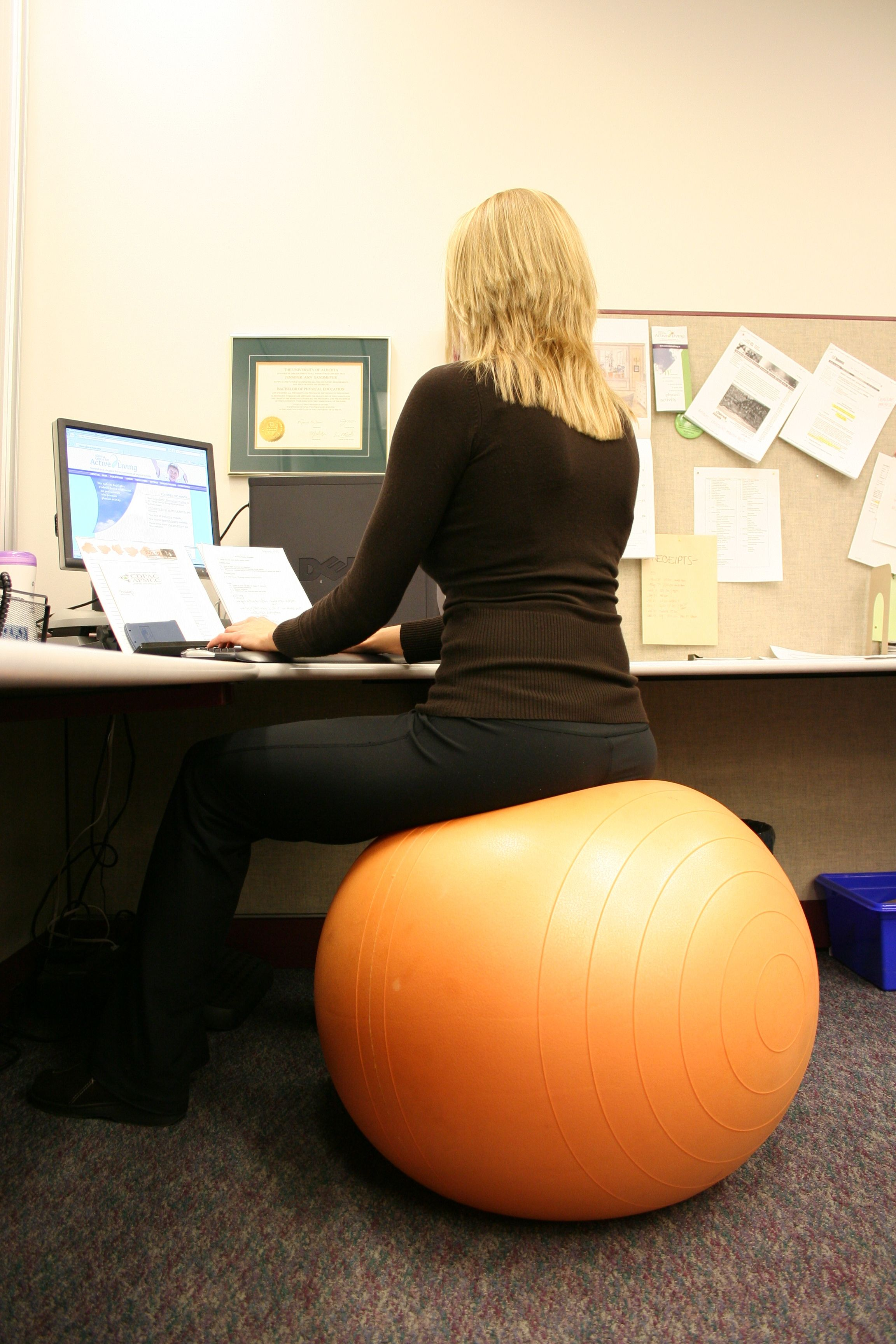 I have been sitting on an exercise ball in place of an