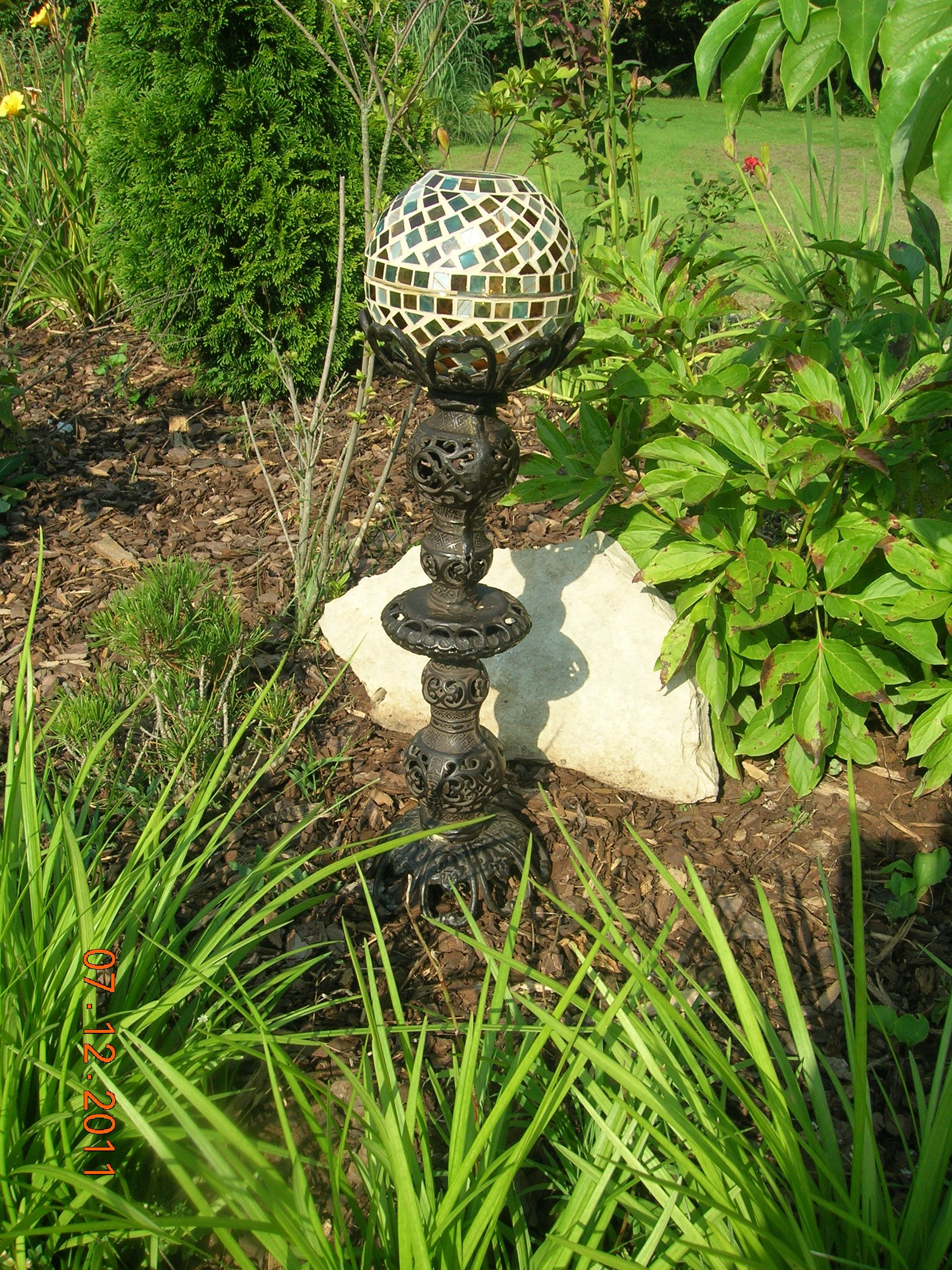 Garden decor out of junk  Made from two candle sticks and two lamp globes  Enrichment Camp