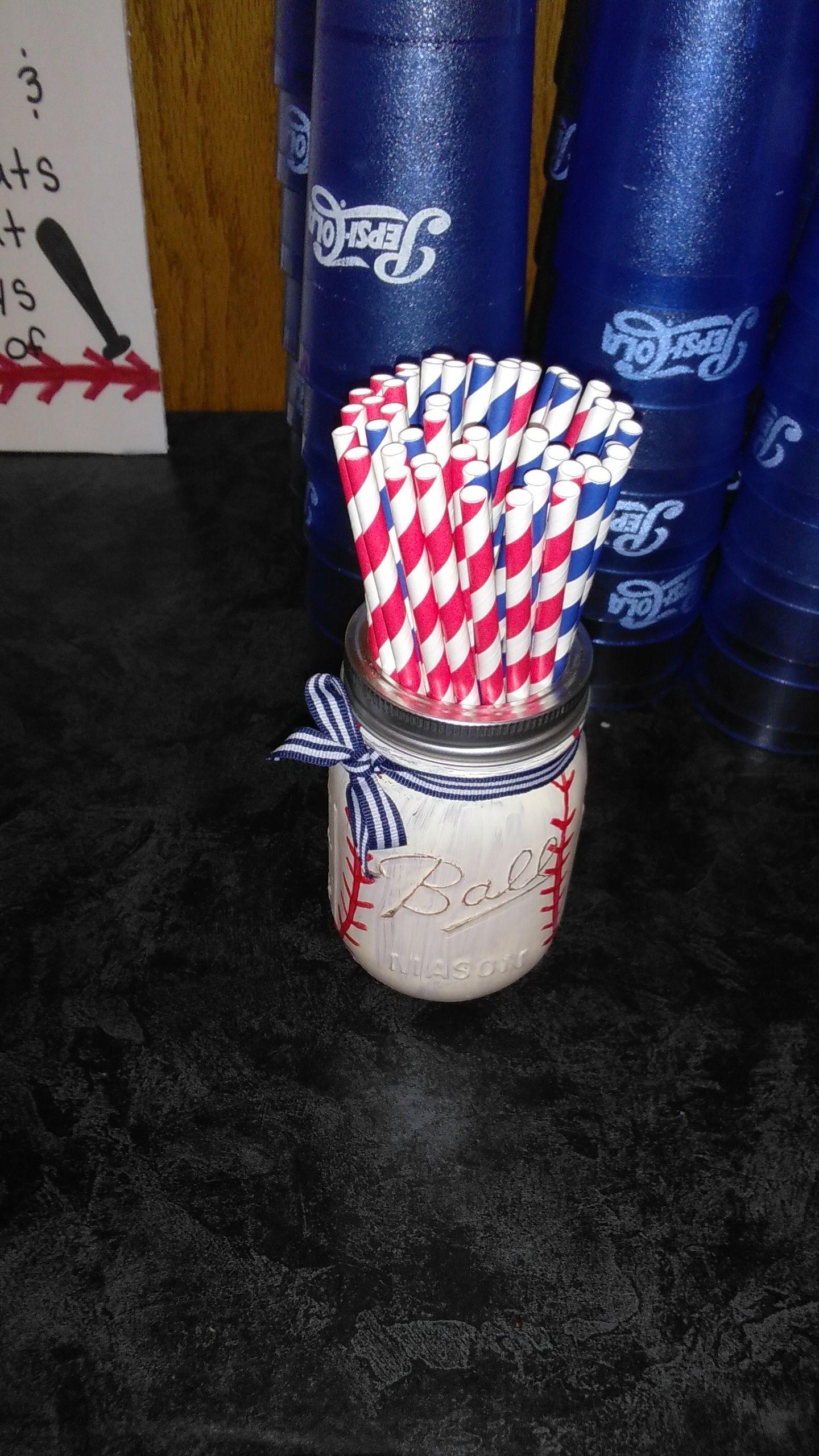 Mason ball jar painted to look like a baseball later put handprint
