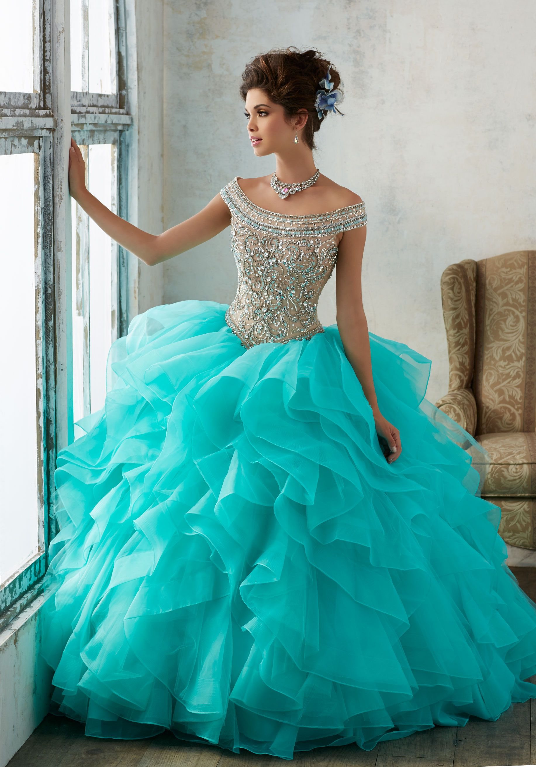 911b58e1f14 Quinceañera Ballgown featuring a Beaded Bodice with Off-the-Shoulder  Neckline and a Flounced Organza Skirt Accented with Horsehair Trim.