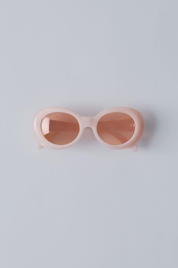 6e501bba07 Acne Studios Mustang pink fluro pink are handmade oval frame acetate eyewear .