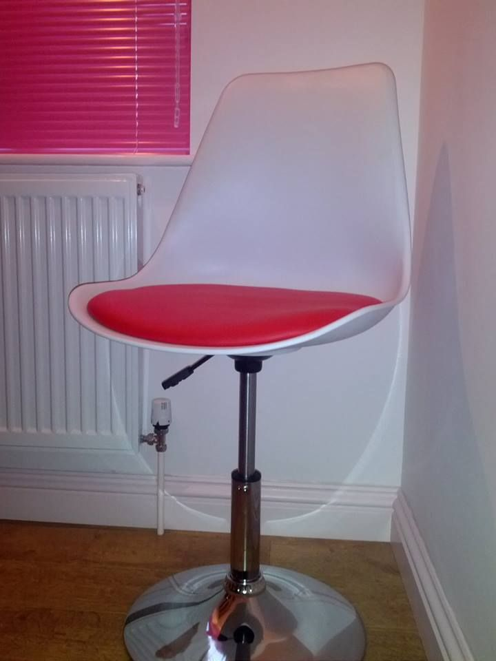 A Tulip white with red cushion chair in our customers home available for a special price : office chairs for customers - Cheerinfomania.Com