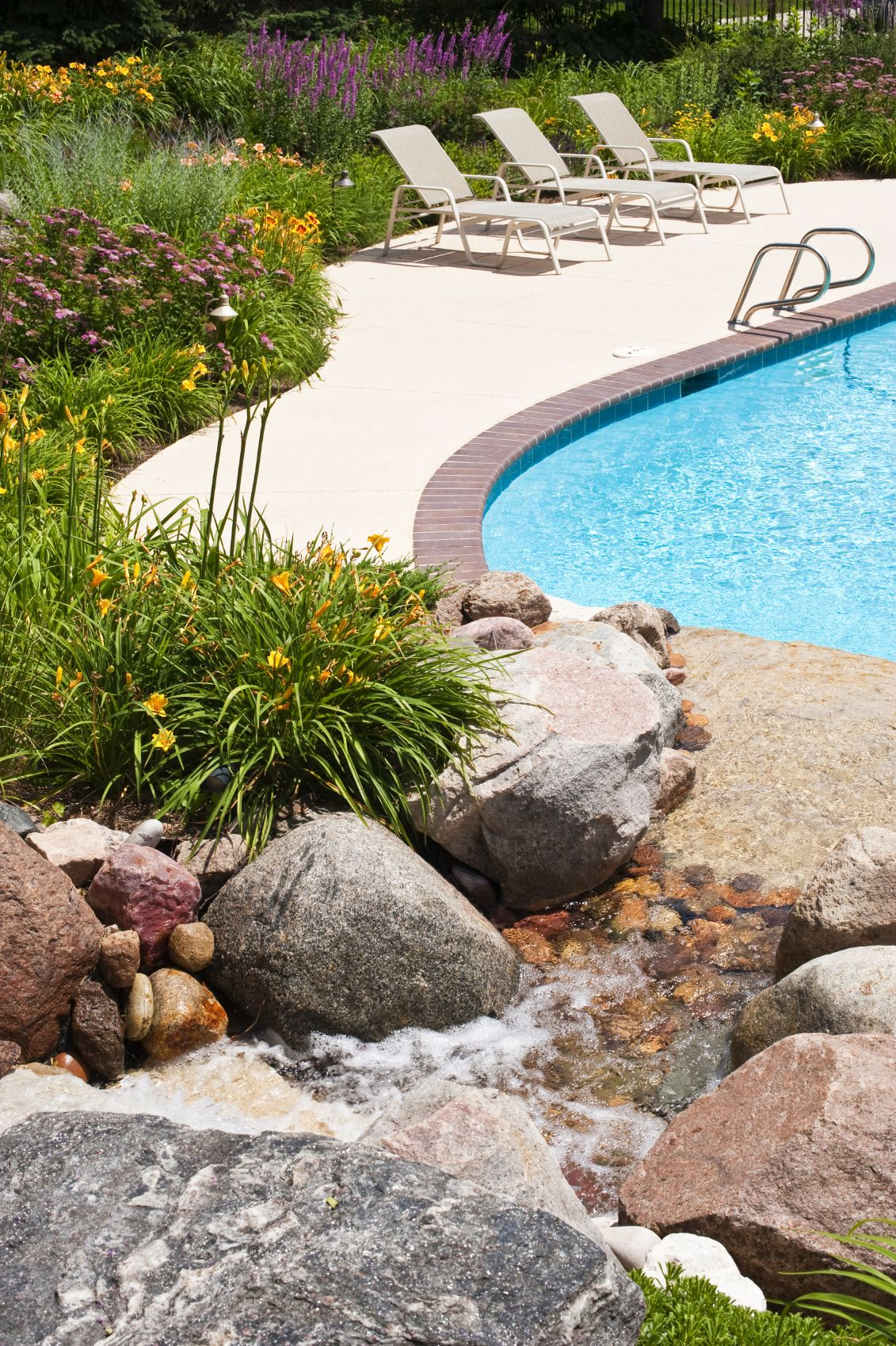 Filter your water through a faux waterfall that flows into the pool