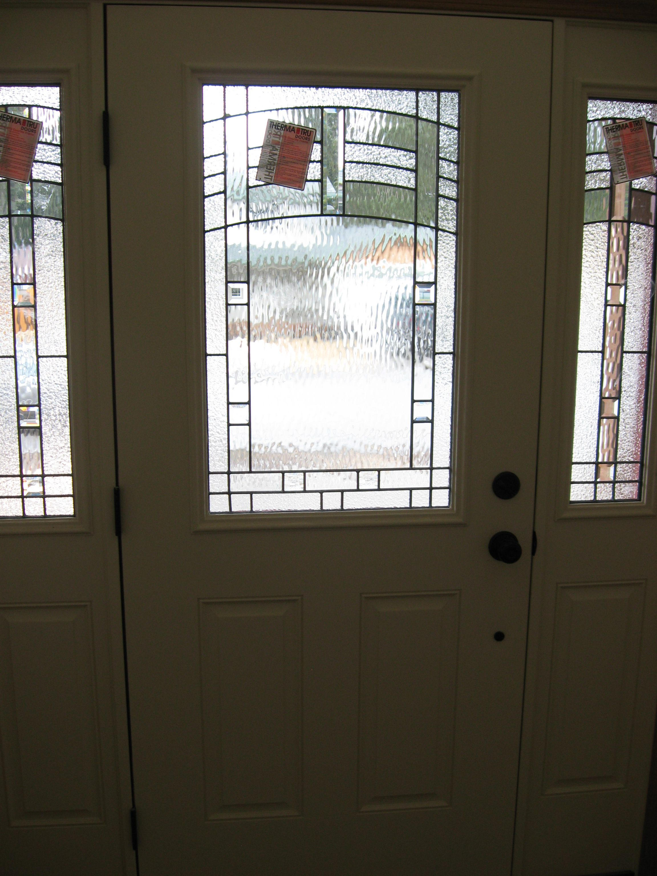 I found this Therma Tru door with Maple Park glass on a house under construction. This photo is from inside looking out. You get daylight but also privacy.