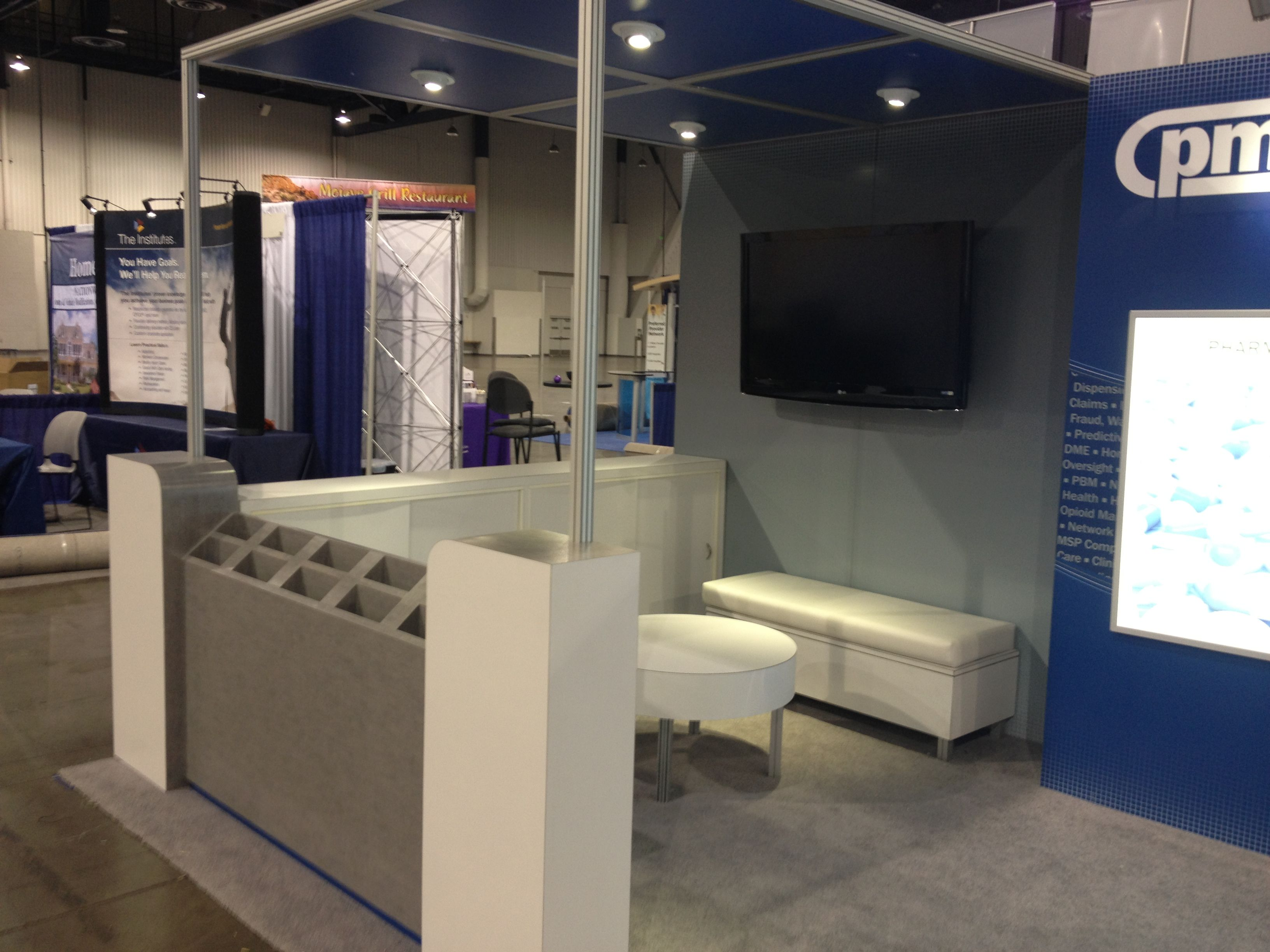 Interior Design Trade Shows pmsi lounge area in the custom trade show booth we helped design