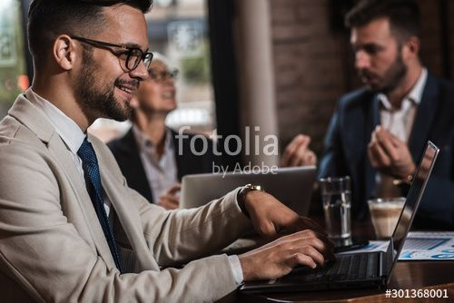 Senior businesswoman holding a meeting with her younger colleagues at office cafeteria