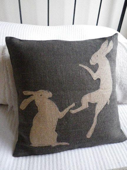 charcoal hand printed tumbling hares cushion cover.
