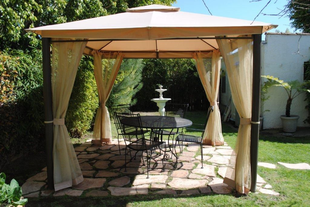 Cream Patio Gazebo Above The Dark Round Table Set Combined With