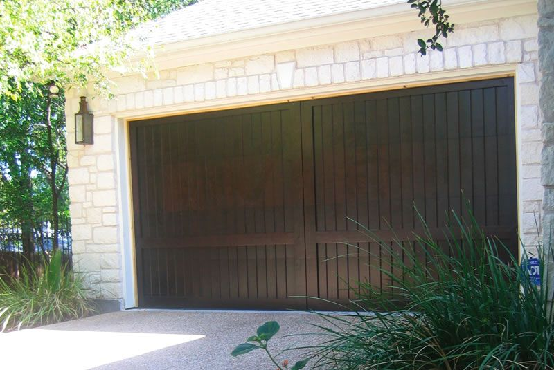 Dark walnut stain on custom wood garage door downtown for How to stain a wood garage door