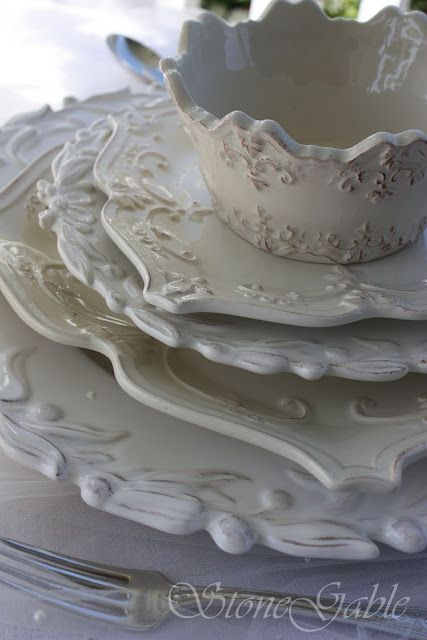 Heavily detailed white and ivory ironstone dishes.           ****