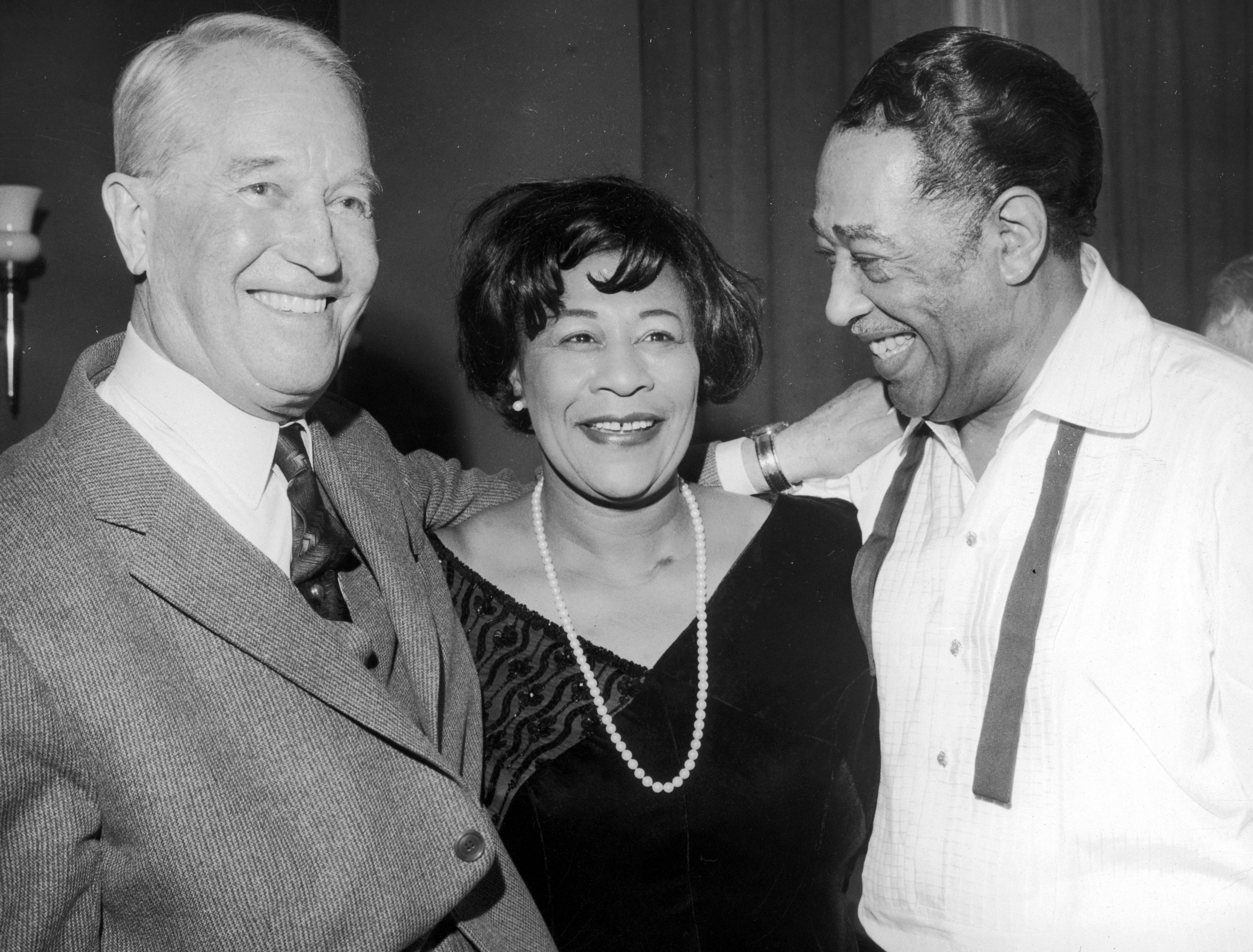 30th January 1966.:  Headshot of American jazz singer Ella Fitzgerald with French actor Maurice Chevalier (L) and composer and bandleader Duke Ellington (1899 – 1974), at the Salle Pleyel, Paris, France.