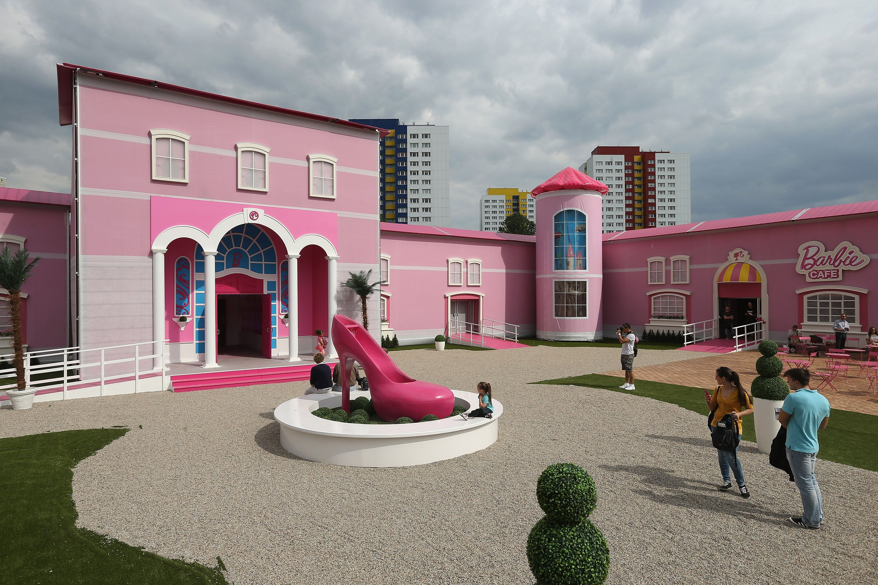Womens rights protesters disrupted the opening of a giant pink dolls house in berlin yesterday saying the barbie dreamhouse experience objectified women