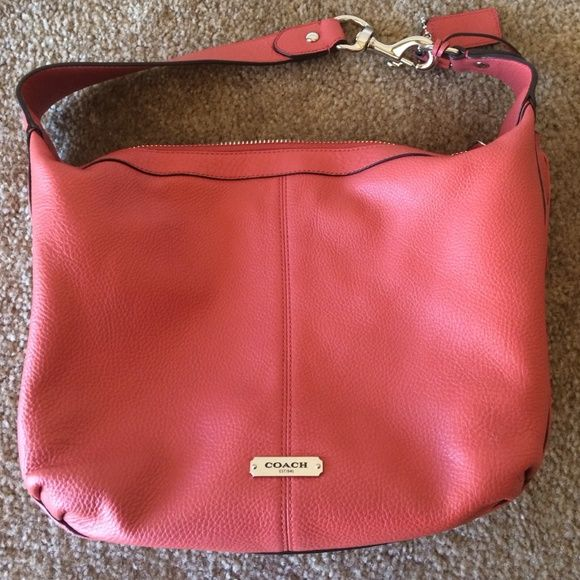 Twice used, pristine condition leather coral Coach Zero signs of use on this beauty. I purchased for a specific outfit and event but haven't touched it since. Silk interior with several pockets, silver hardware, fob and tassel attachment. Pairs perfectly with coral wallet in my closet- 10% bundle discount, all from a smoke free home - Happy Shopping! Coach Bags Hobos