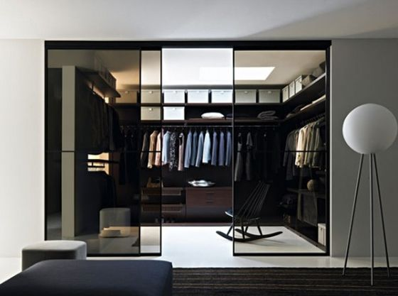 modern closet with sliding tinted glass doors | Walk in closet design, Glass closet, Closet designs