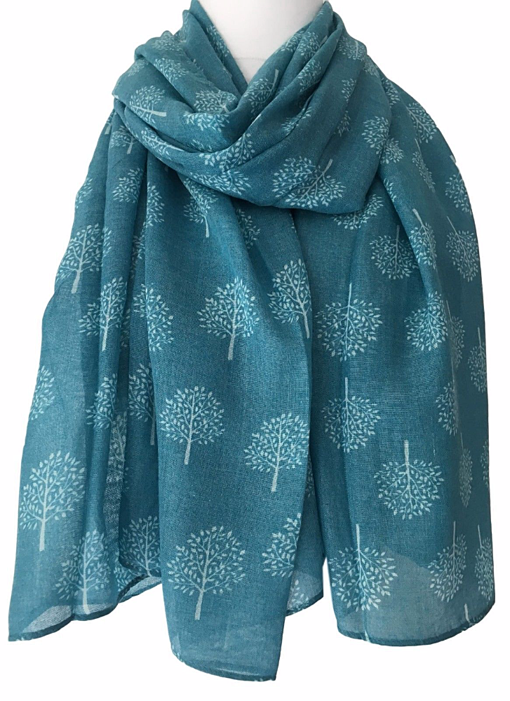A Large Blue Scarf With White Tree Print The Is Long Wide And Very