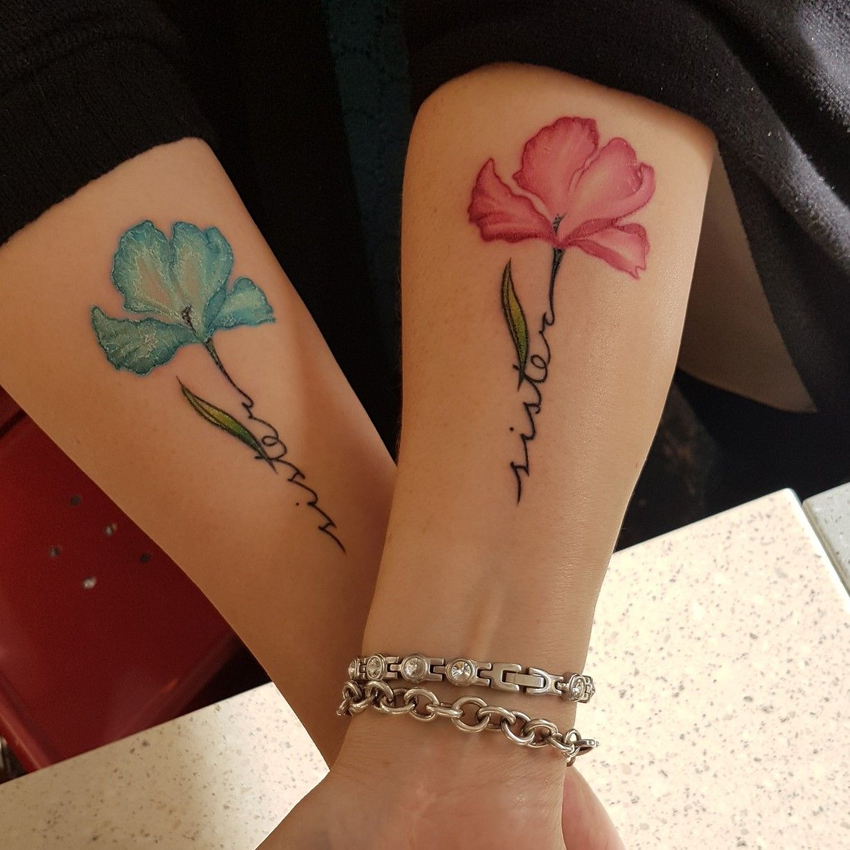 My new sister tattoo. I got the pink one and my sister blue. We got ...