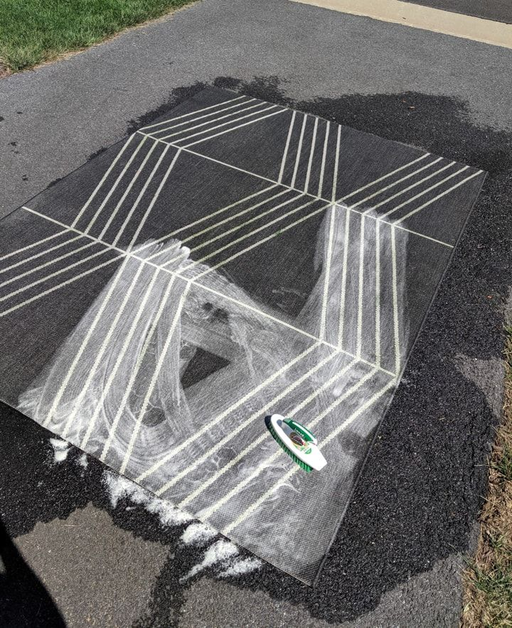 How to clean an outdoor rug easily removing dirt and