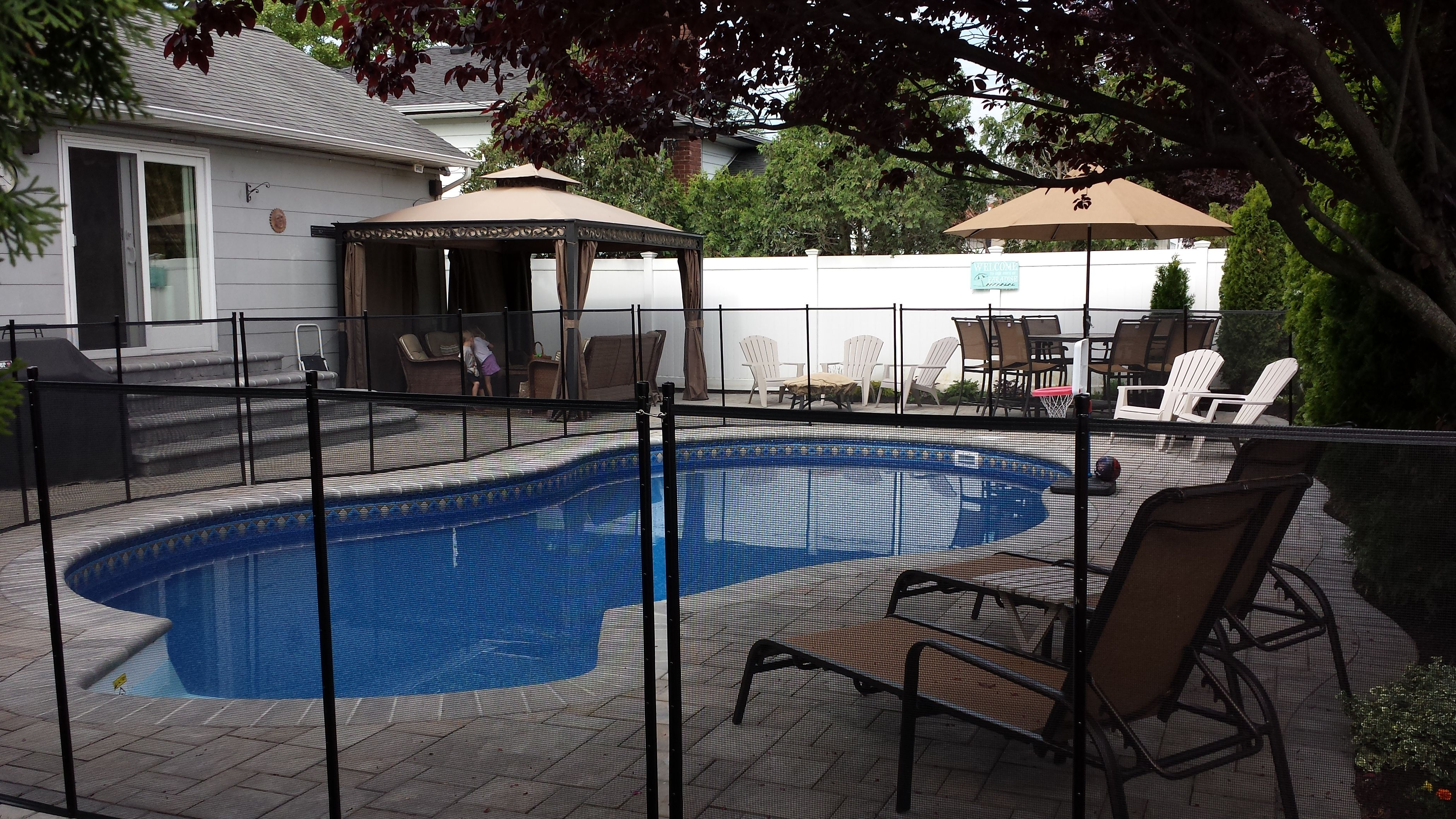 16x28 radiant in ground freeform pool with safety fence