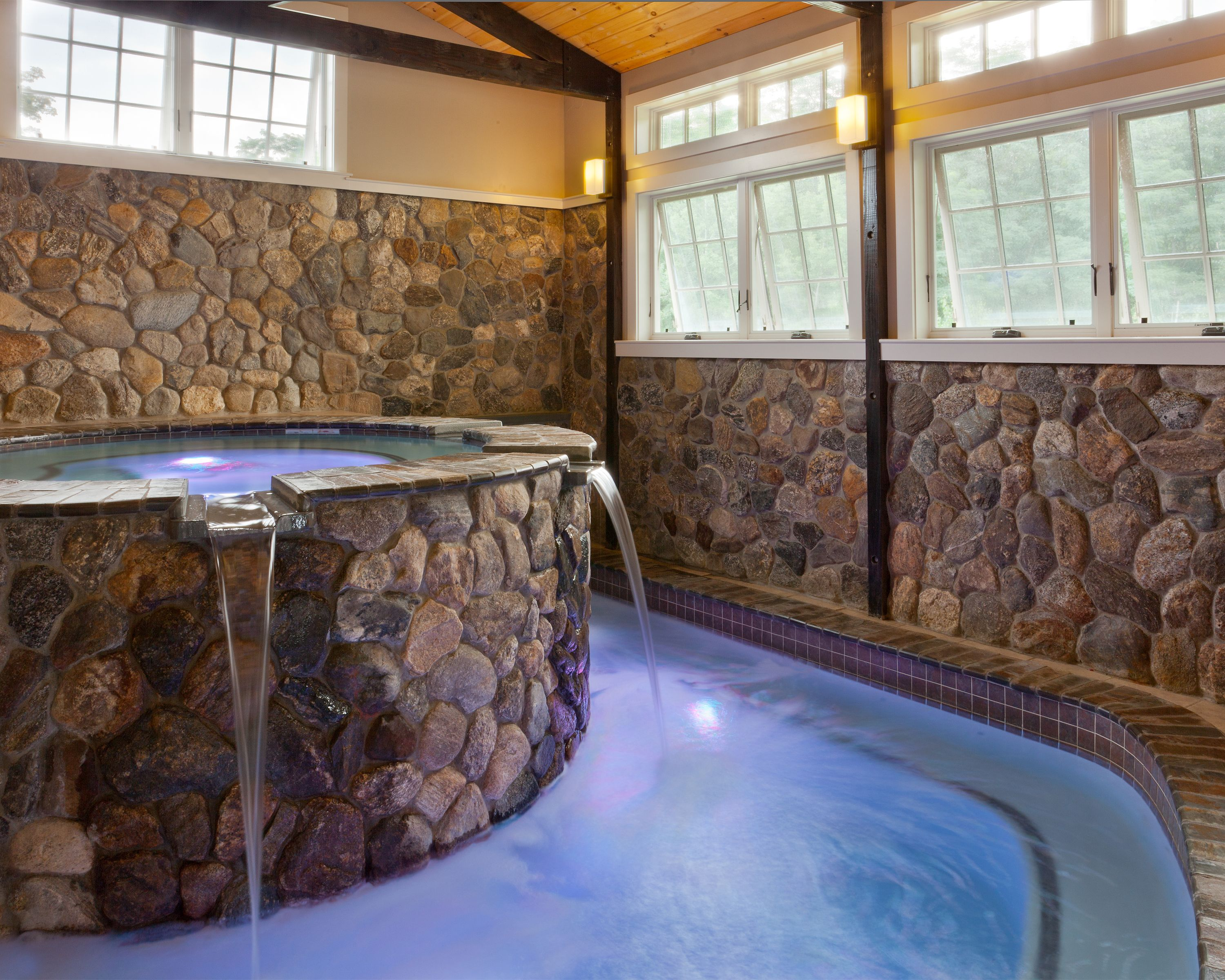 Enjoy a soothing experience in the indoor hot tub during your ...