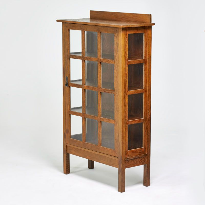 "L. & J. G. STICKLEY - Estimate: $1,200 - $1,800 - Single-door china cabinet with gallery top, Fayetteville, NY, ca. 1910; Quartersawn oak, hammered copper, glass; 60"" x 36"" x 15"""