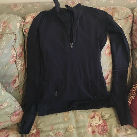 Lululemon black 1/2 zip pullover, size 2 Lululemon black 'Race with Grace' 1/2 zip pullover. Size 2. 2 front pockets. Thumb-holes. Reflective strips on both arms and bottom of the back. Great condition. No pilling, no pilling. Only worn a few times. lululemon athletica Tops