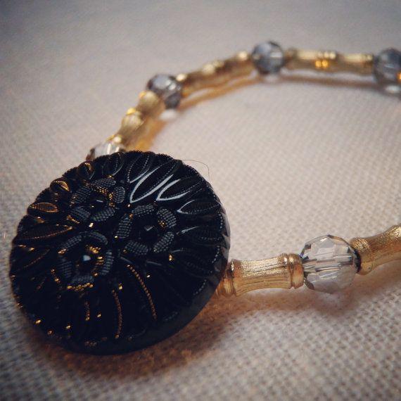 Black & Gold stretch bracelet $26.00 Check out this item in my Etsy shop https://www.etsy.com/listing/168053886/black-and-gold-vintage-button-bracelet