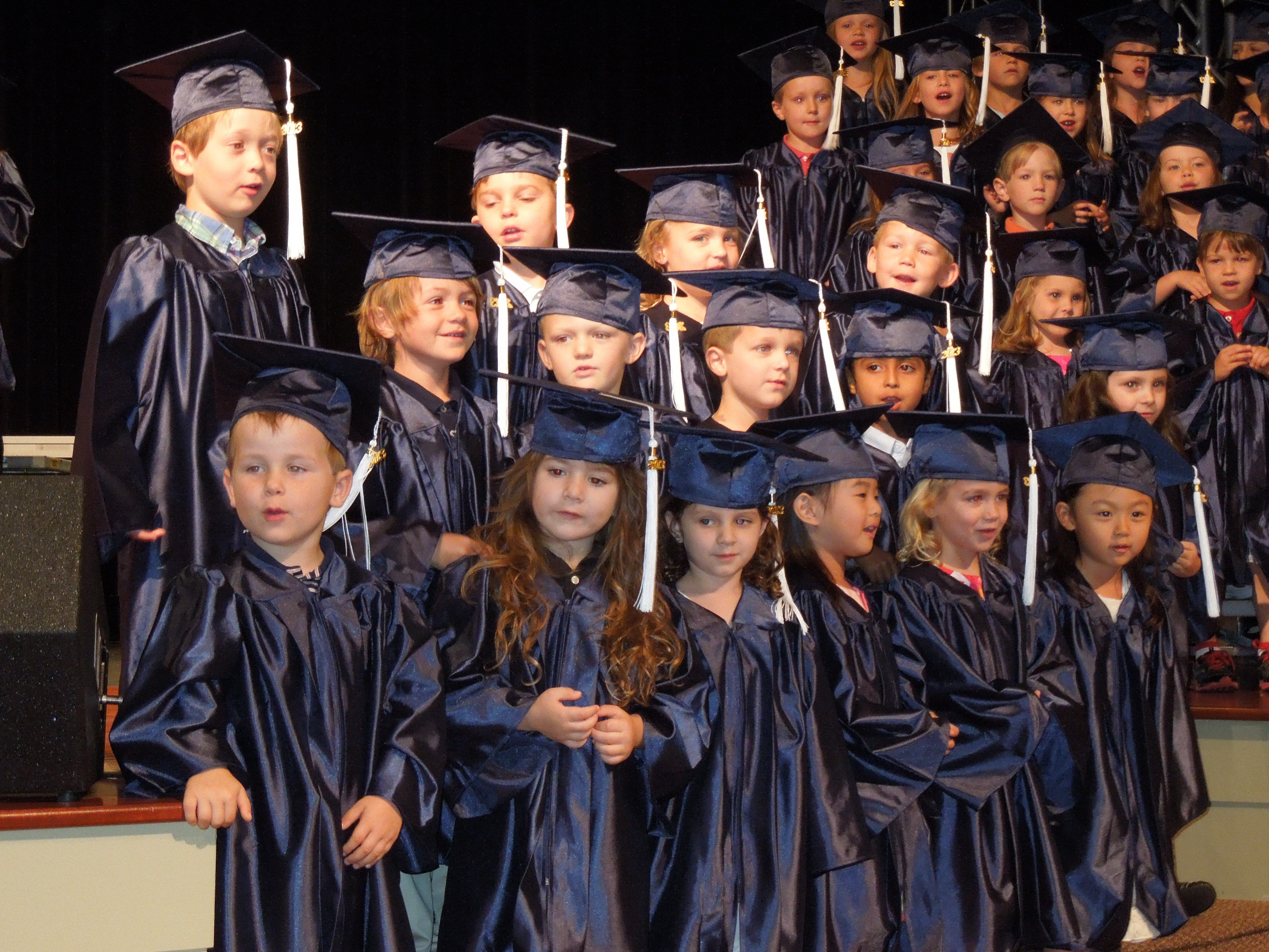 Each year the pre-k students wear a cap and gown and have an ...