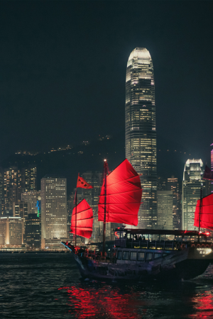 Traditional Chinese junk boat sailing across Hong Kong harbour