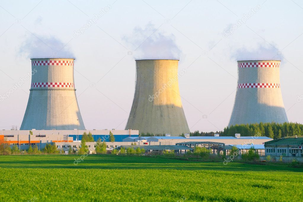 Power Plant With Huge Cooling Towers Against Blue Sky Stock Photo