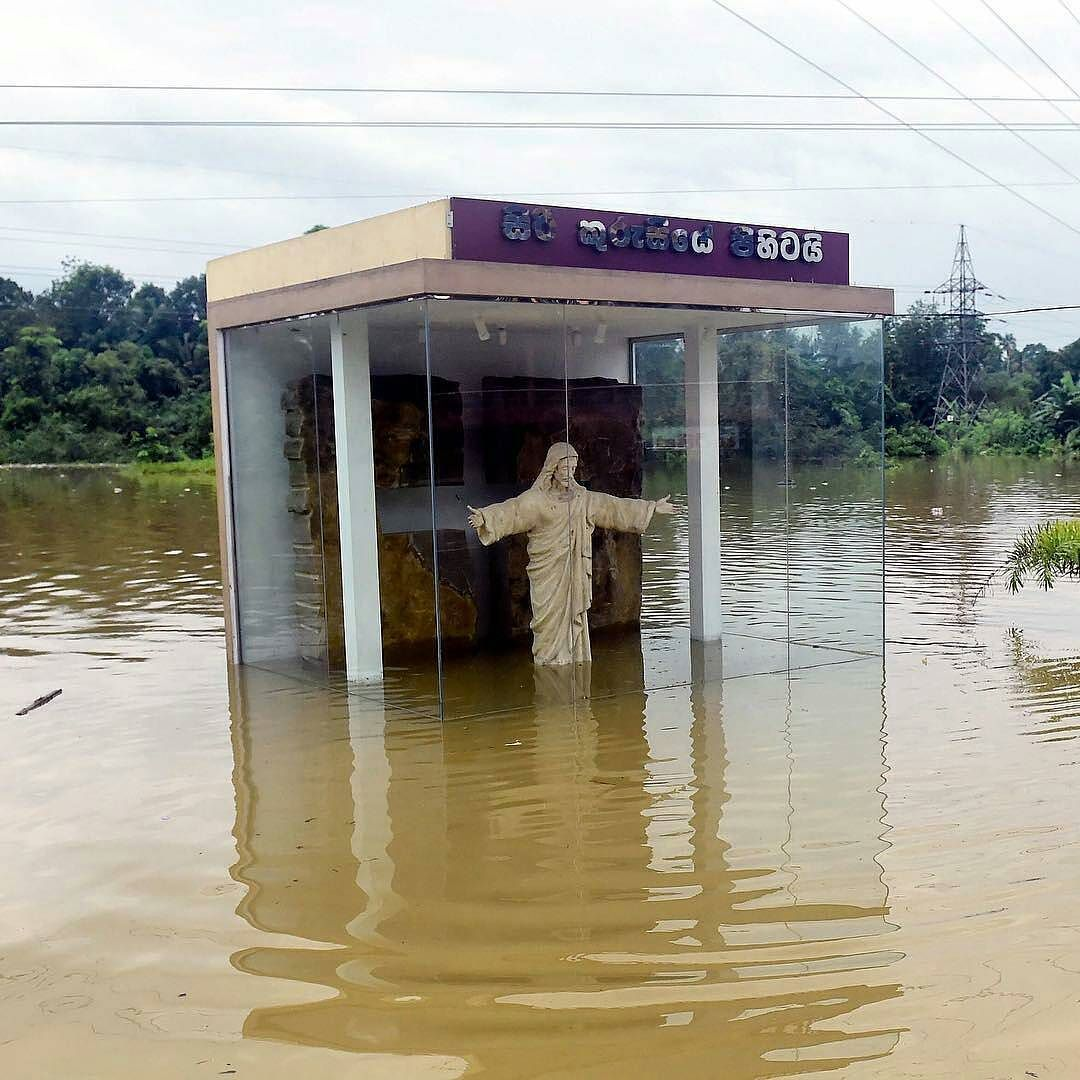 @Regrann from @time -  A roadside statue in the likeness of Jesus Christ is submerged by floodwaters in Pugoda about 35 kms from the capital of Colombo Sri Lanka May 17 2016. Heavy rains claimed three more lives in Sri Lanka on May 17 raising weather-related deaths to 11 as more than 50000 families were driven out of their flooded homes officials said. Photograph by Ishara S. Kodikara@afpphoto. #Regrann