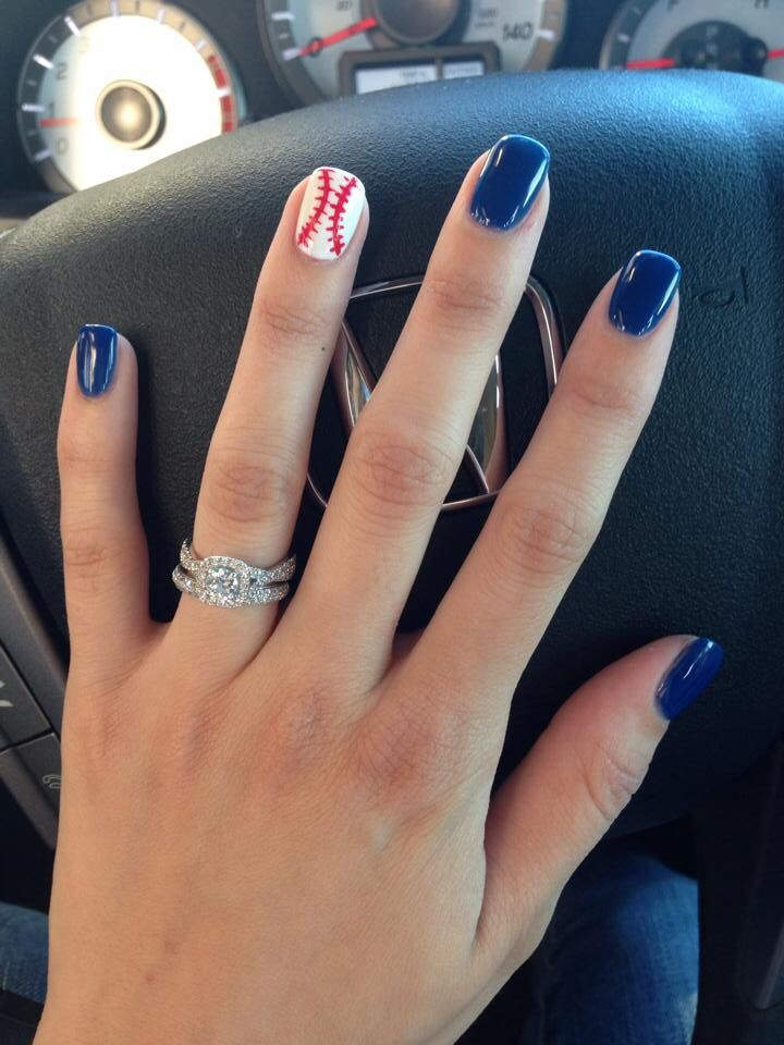 I'm not crazy about blue nails but thats our color...this is what it'd look like except I'd angle the baseball stitching.