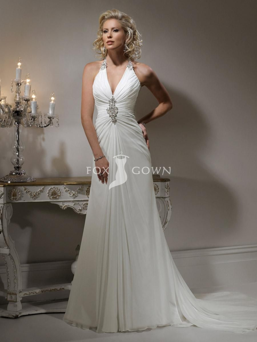 Slim aline gown with halter neckline and zipper over inner corset