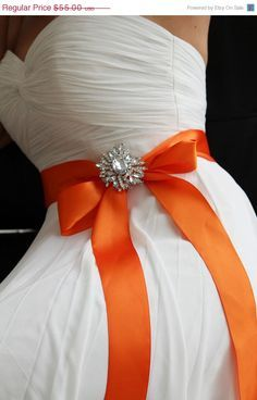 White wedding dress with orange bow and
