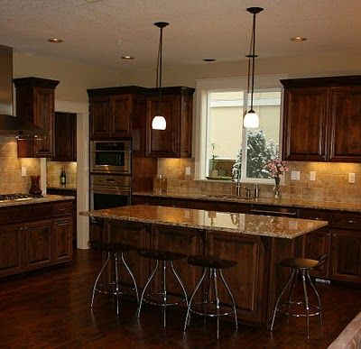 Another set of dark cabinets - with mid-tone counter  back splash