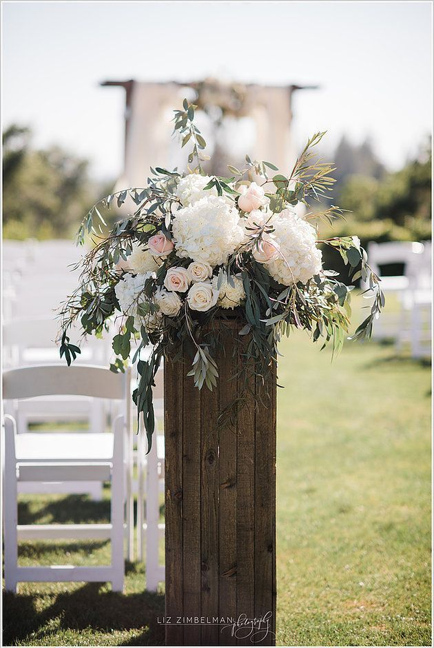The entrance to the ceremony was defined with large floral arrangements of hydra... -