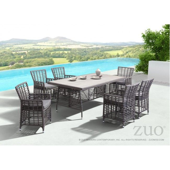 The wide, rectangular weave and simple cushion of the Sandbanks chair are a nice foil to the slimmer lines of the matching table. Its aluminum frame is water resistant for outdoor use. Sold separately.
