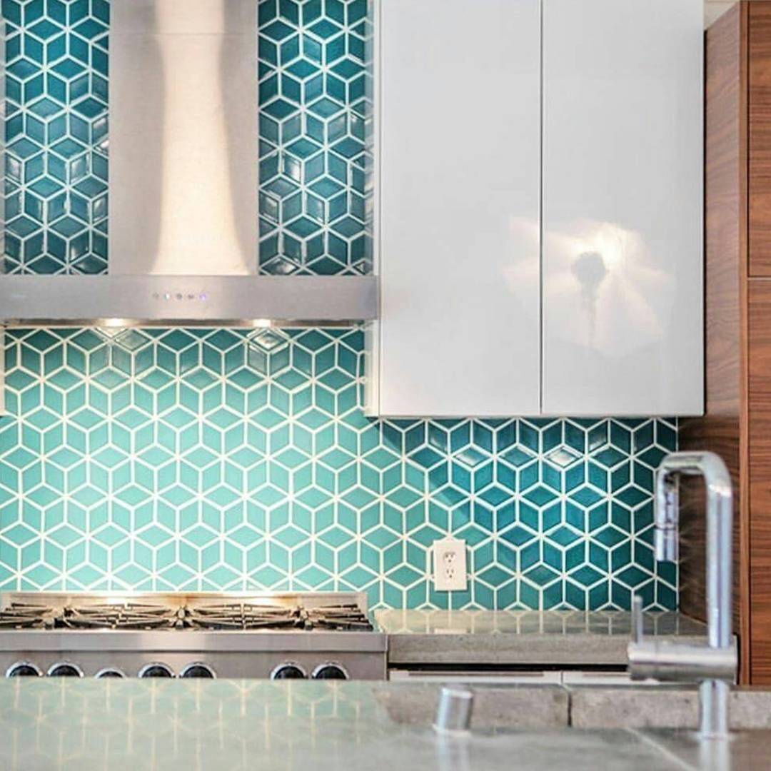 Beautiful geometrical backsplash. The color is so soothing ...