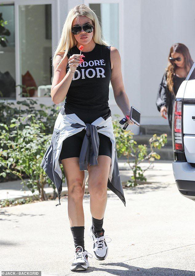Khloé Kardashian dons Dior and sucks on a lollipop as she house hunts #khloekardashianhouse Khloé Kardashian dons Dior and sucks on a lollipop as she house hunts #khloekardashianhouse