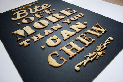 """Bite off more than you can chew comes from designer Anna Garforth. She said """"I thought to myself what could I ever love more than a good cuppa and a biscuit…typography. So there you have it, a home baked poster fresh out the oven."""""""