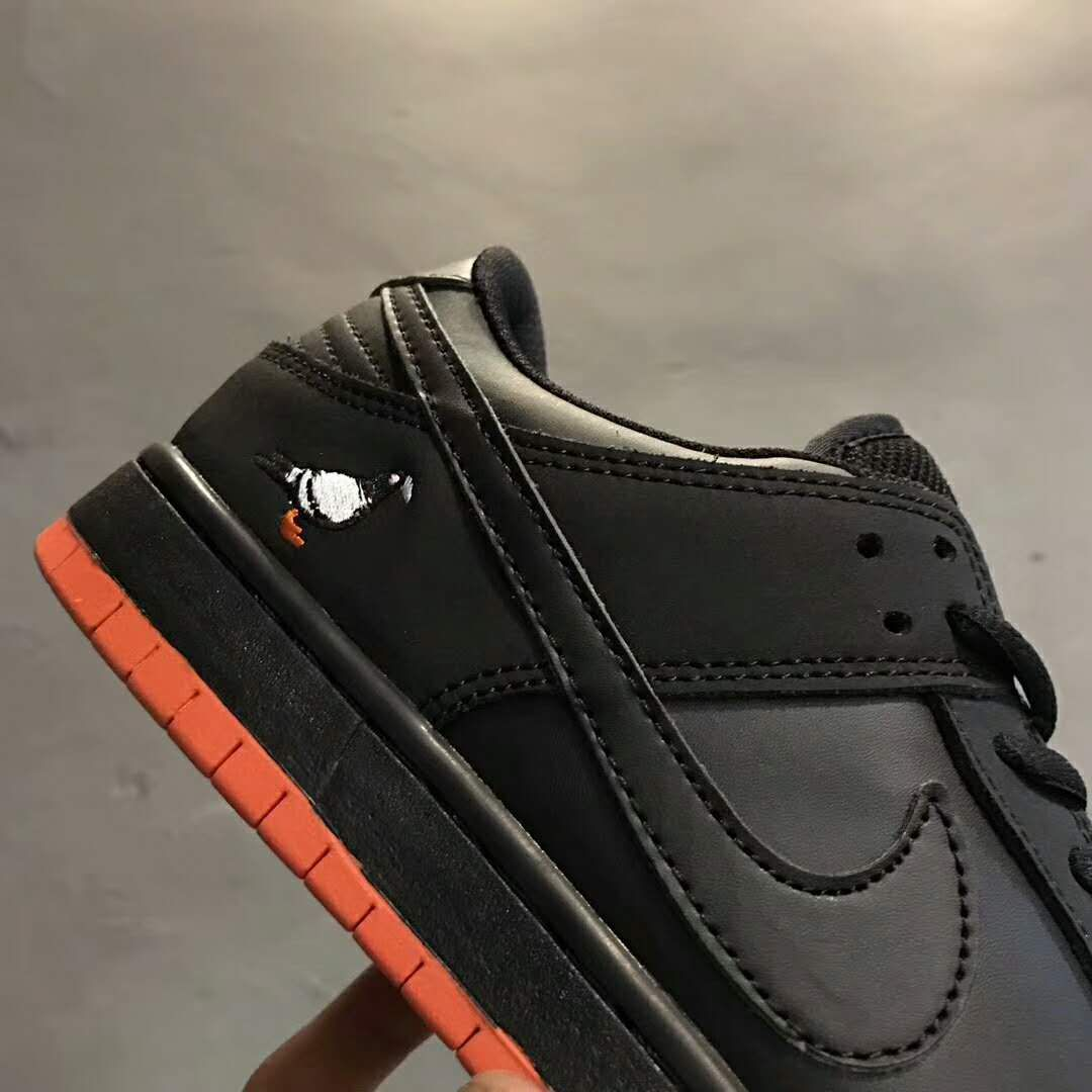 "e7f83a7b26c8 Jeff Staple s Nike SB Dunk Low ""Pigeon"" is featuring a new all-black upper  with the return of the pinkish-red ""Sienna"" tone."
