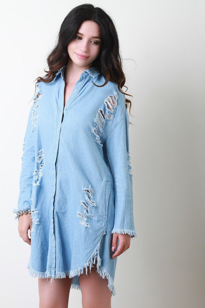 c89e424bf36 Distressed denim dress with button up front. Collar neckline with long  sleeves. Back keyhole cutout. Side pockets and rounded fringed hem.