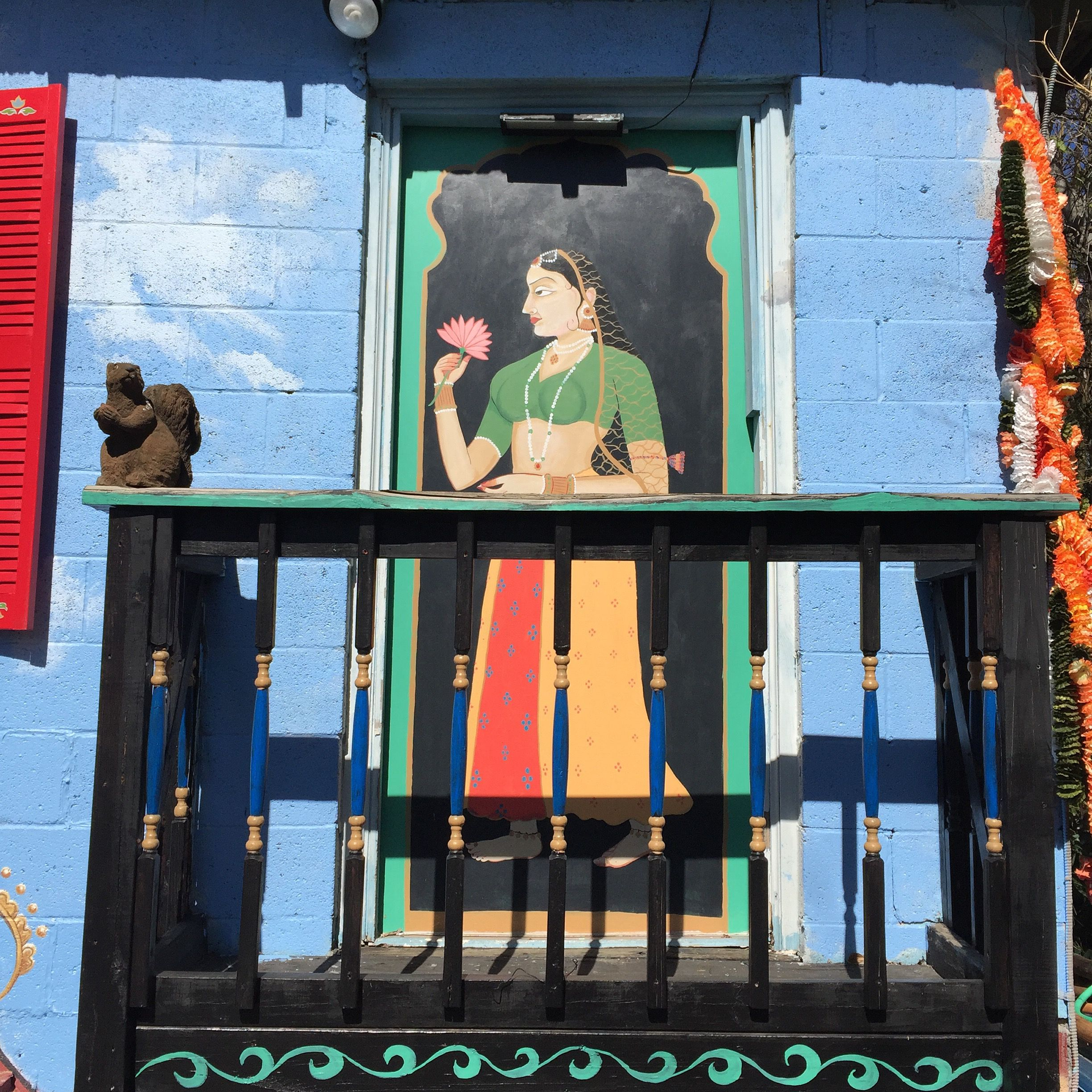 A Poetic Mural Of A Woman Painted On A Balcony Door For A