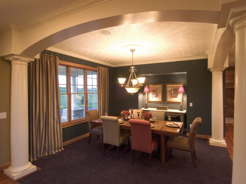 Plush DIning Room Outlined By White Columns