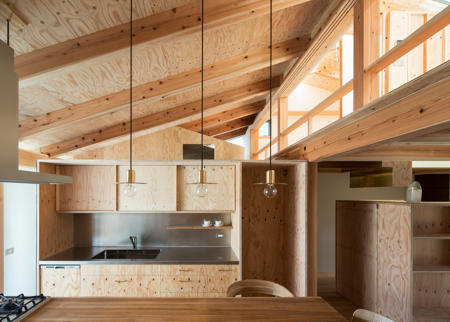 Small house by Hitotomori has custom made plywood interior