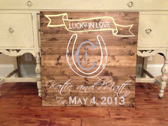 Lucky in Love custom wedding sign with cursive names and date.