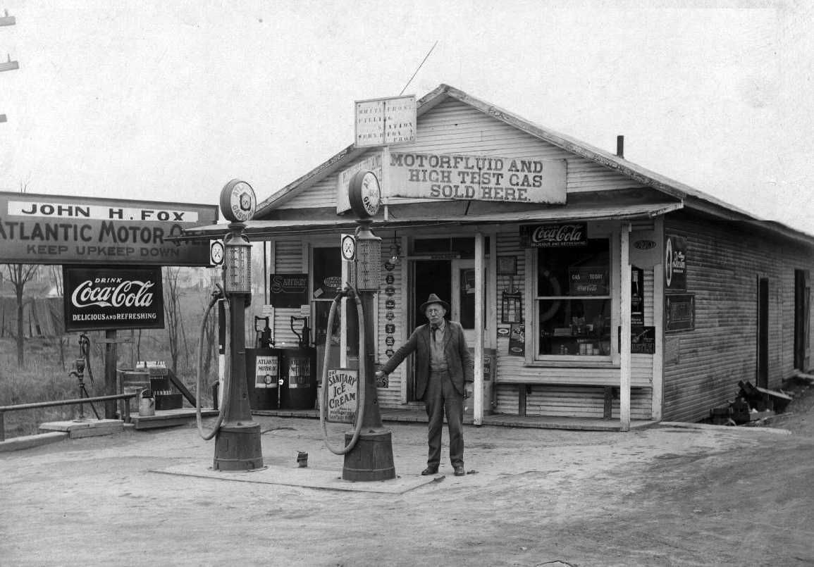 historic service stations John Fox in front of his gas