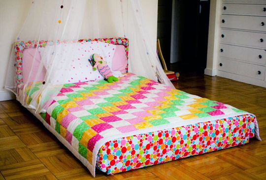 This quilt is cute. I would probably substitute one of the pinks for a blue, and use a proper yellow, instead of orange-yellow.