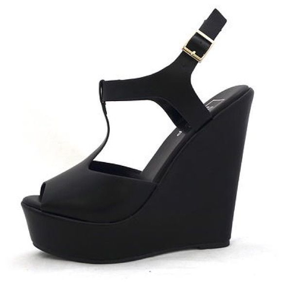 "NWT ShuShop Black Wedges Classic peep toe T-strap wedges are stylish and comfy with platform and lightly cushioned insole. Adjustable strap for personal fit.  Platform measures approximately 1.5"" Heel measure approximately 5.5"" ShuShop Shoes Wedges"